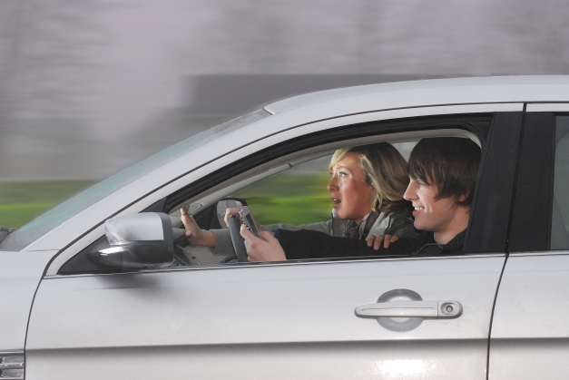Teen Driving and Texting by Photographer Vince Rush of Lynx Telematics